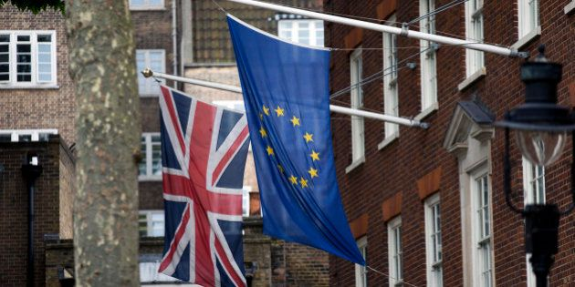 FILE -In this June 22, 2016 file photo, a European Union flag, right, and a Union are displayed outside...