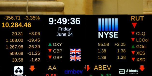 A board above the floor of the New York Stock Exchange (NYSE) shows the current standing of the British...