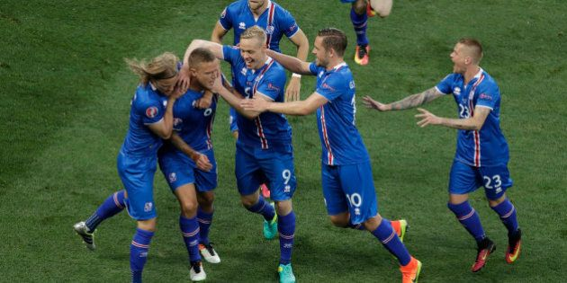 Iceland players celebrate after their teammate Ragnar Sigurdsson, second from left, scored during the...