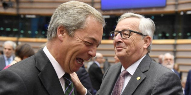 European Commission President Jean-Claude Juncker, right, greets UKIP leader Nigel Farage during a special...