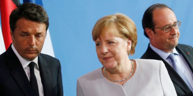 German Chancellor Angela Merkel (C), French President Francois Hollande (R) and Italian Prime Minister...