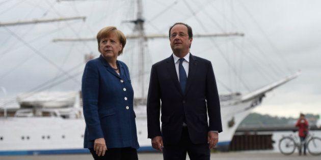 Hollande et Merkel menacent de sanctionner la Russie si l'élection présidentielle en Ukraine ne se tient...