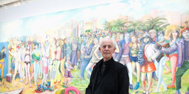 PARIS, FRANCE - MAY 12: Artist Martial Raysse poses in front of his painting 'Ici plage comme ici-bas'...