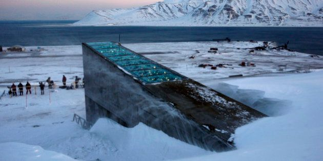 Snow blows off the Svalbard Global Seed Vault before being inaugurated at sunrise, Tuesday, Feb. 26,...