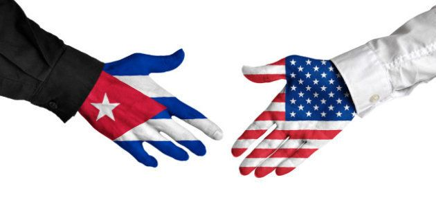 Diplomatic handshake between leaders from Cuba and the United States with flag-painted