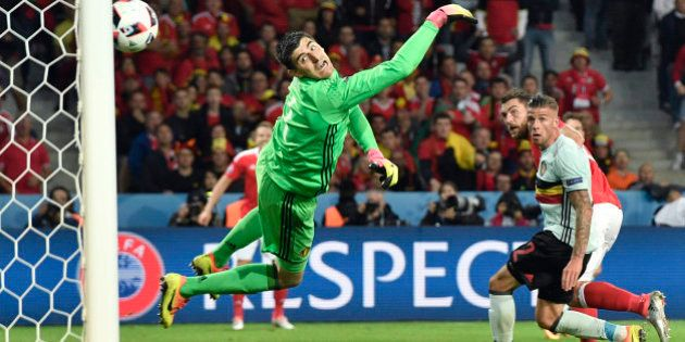 Wales' Sam Vokes, 2nd right, scores his side's third goal past Belgium goalkeeper Thibaut Courtois,...