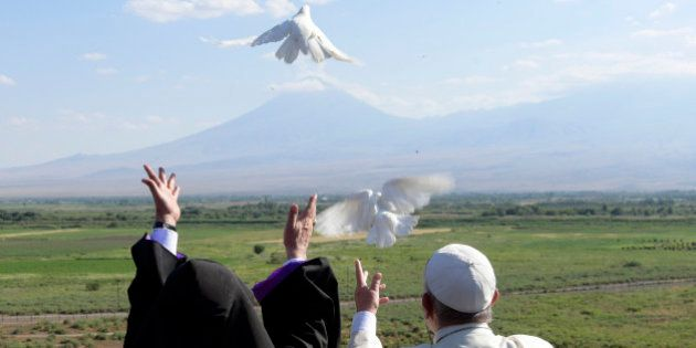 Pope Francis, right, and Catholicos Karekin II release white doves in front of Ararat's mountain after...