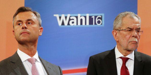 Presidential candidates Alexander Van der Bellen (R) and Norbert Hofer react during a TV debate in Vienna,...