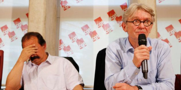 French Force Ouvriere (FO) labour union General Secretary Jean-Claude Mailly (R) and French CGT trade...