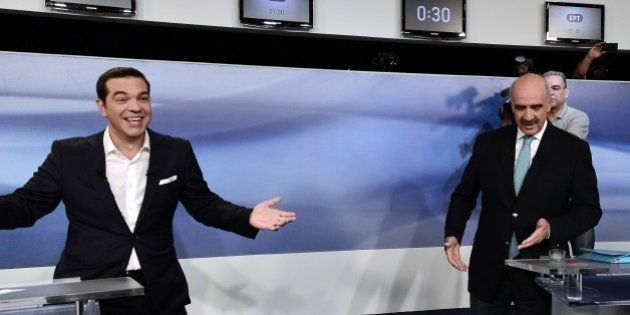 Former Greek Prime Minister and leader of the left-wing Syriza party Alexis Tsipras (L) jokes with main...