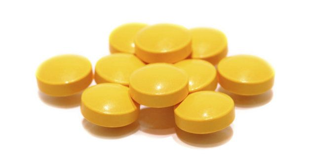 pill of vitamin C on white
