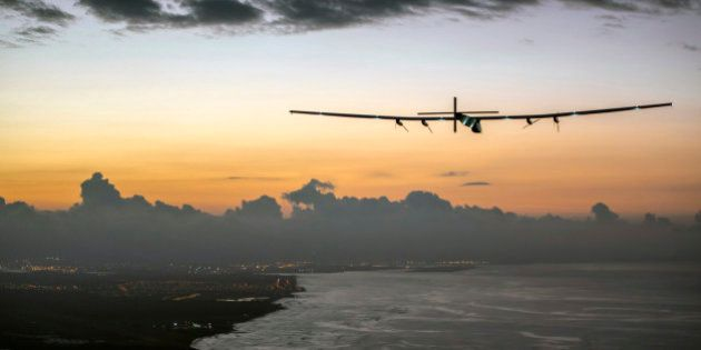 In this photo provided by Jean Revillard, Solar Impulse 2, a plane powered by the sun's rays and piloted...