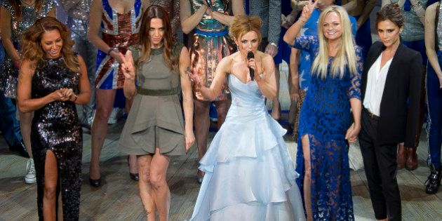 Mel B, from left, Mel C, Geri Halliwell, Emma Bunton, and Victoria Beckham take the applause on stage...