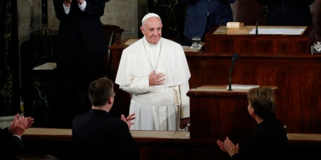 Vice President Joe Biden and House Speaker John Boehner of Ohio and others applaud Pope Francis as he...