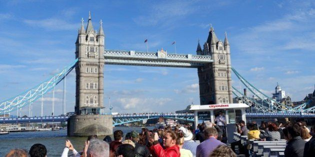 In this May 21, 2015 photo, a London City Cruises boat tours the River Thames near the Tower Bridge in...