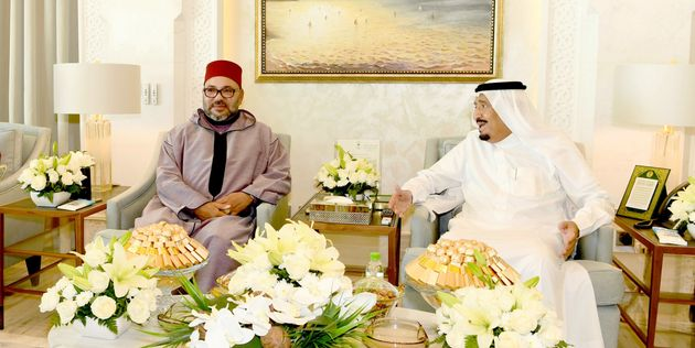 In this photo provided by the Moroccan Royal Palace Saturday, Aug. 12, 2017, King Mohammed VI, center,...