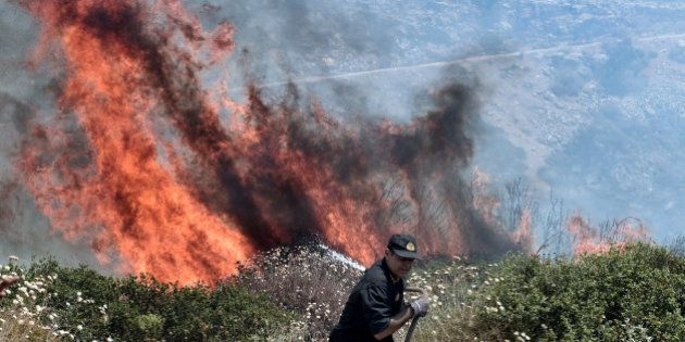 PHOTOS. Les alentours d'Athènes ravagés par des incendies de