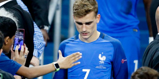 France's Antoine Griezmann walks down the tribune at the end of the Euro 2016 final soccer match between...