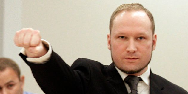 Mass murderer Anders Behring Breivik, makes a salute after he arrives at the court room in a courthouse...