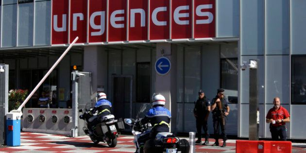 Riot olice officers and gendarmes are pictured outside the Pasteur Hospital in Nice, southern France,...