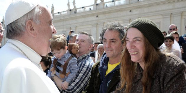 US artist Patti Smith, right, is greeted by Pope Francis at the end of his weekly general audience, in...