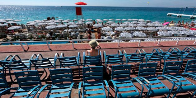 A woman enjoys a warm and sunny summer day on the Promenade Des Anglais in Nice, August 8, 2014. REUTERS/Eric...
