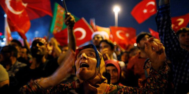 Supporters of Turkish President Tayyip Erdogan attend a pro-government demonstration on Taksim square...