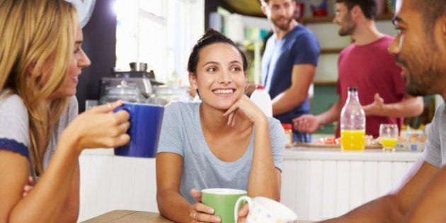 Group Of Friends Enjoying Breakfast In Kitchen