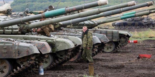 Ukraine: moins de violences avant la réunion des chefs d'État à Paris, mais rien n'est