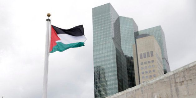 The State of Palestine flag flies for the first time at U.N. headquarters, Wednesday, Sept. 30, 2015....