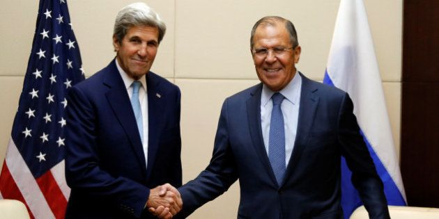 U.S. Secretary of State John Kerry (L) greets Russia's foreign minister Sergey Lavrov during a bilateral...
