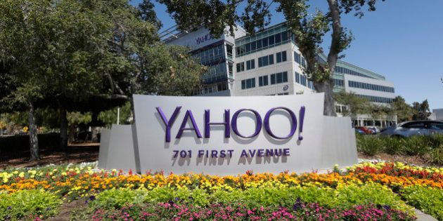 Flowers bloom in front of a Yahoo sign at the company's headquarters Tuesday, July 19, 2016, in Sunnyvale,...