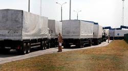 Ukraine : Des camions du convoi d'aide humanitaire retournent en