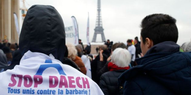 People attend a demontration against Daech with the message on a shirt with the EIffel