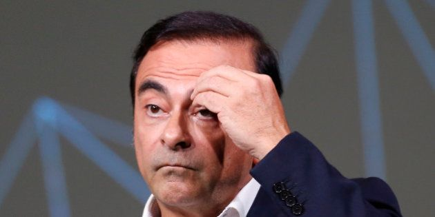 Carlos Ghosn, Chairman and CEO of the Renault-Nissan Alliance, gestures during the presentation of the...