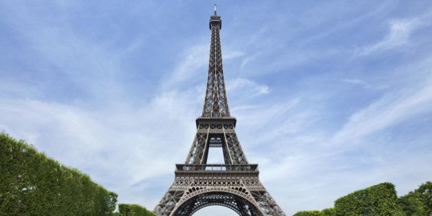 The majestic Eiffel tower in Paris against a blue