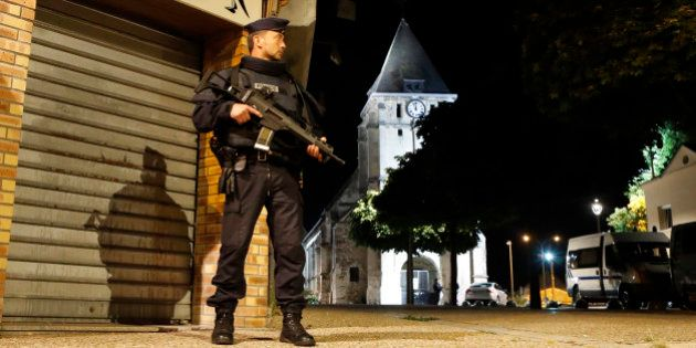 French riot police guards the street to access the church where an hostage taking left a priest dead...