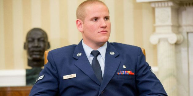 The injured hand of Air Force Airman 1st Class Spencer Stone can be seen as he and Oregon National Guardsman...