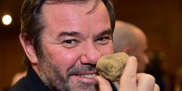 French Chef Michel Troisgros smells a white truffle during the World Alba White Truffles Auction in Grinzane Cavour in northwestern Italy on November 9, 2014. A twin white truffle weighing a total of 1 kilograms has been sold for 100,000 euros to a buyer from Hong Kong today during the traditional aunction.   AFP PHOTO / GIUSEPPE CACACE        (Photo credit should read GIUSEPPE CACACE/AFP/Getty Images)