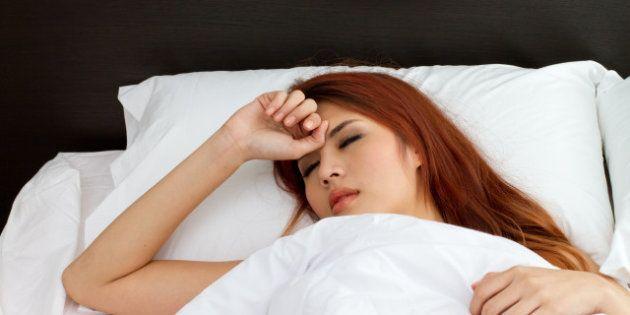 sick woman on bed symptom
