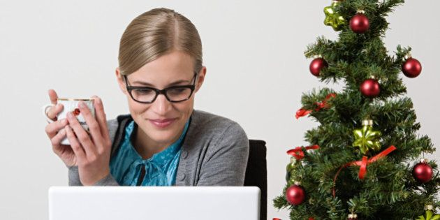 Woman with christmas tree on her desk