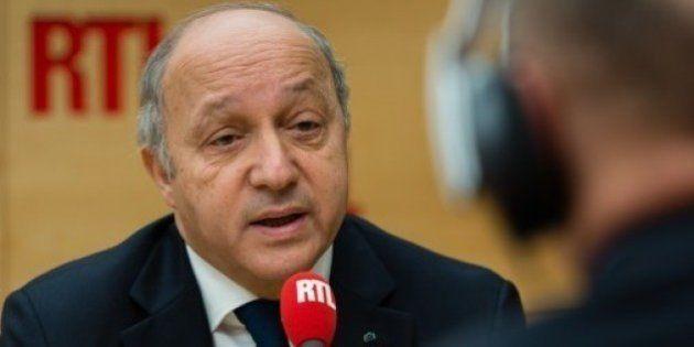 Quotas d'immigration: Fillon salue le référendum suisse, Fabius déplore un résultat