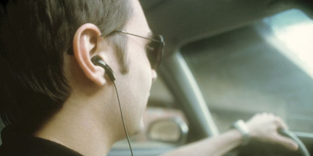 Man wearing cell phone hands-free headset