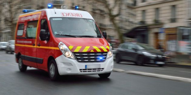 Red emergency vehicle speeding on Paris