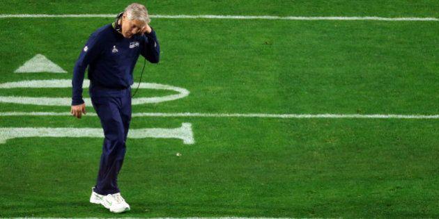 GLENDALE, AZ - FEBRUARY 01: Head coach Pete Carroll of the Seattle Seahawks looks dejected after defeat...