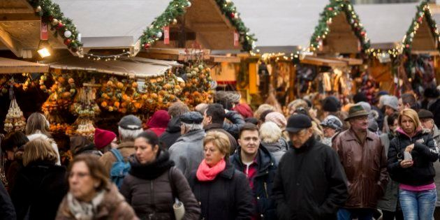 People crowd a Christmas market in a square in central Budapest, Hungary, Sunday, Dec. 20, 2015. (Balazs...