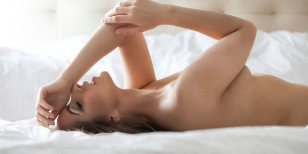 Side view of nude sensual woman lying in