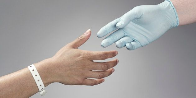 Patient and doctor shaking hands