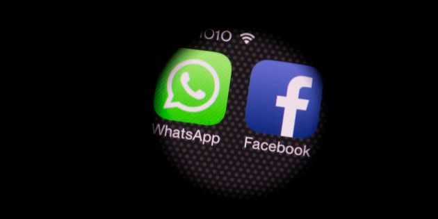 The WhatsApp Inc. mobile-messaging application WhatsApp and the Facebook Inc. application are see through...