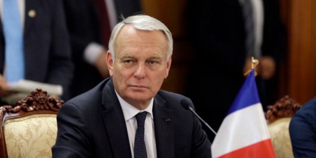 French Prime Minister Jean-Marc Ayrault listens to South Korean Prime Minister Chung Hong-won, unseen,...